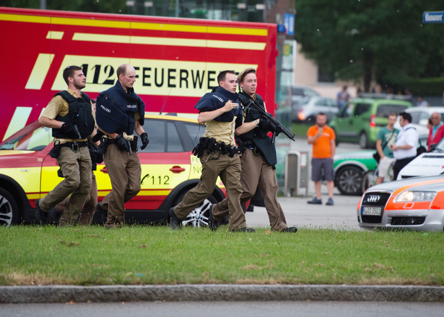 Policemen arrive at a shopping centre in which a shooting was reported in Munich, Friday, July 22, 2016. (Matthias Balk/dpa via AP)