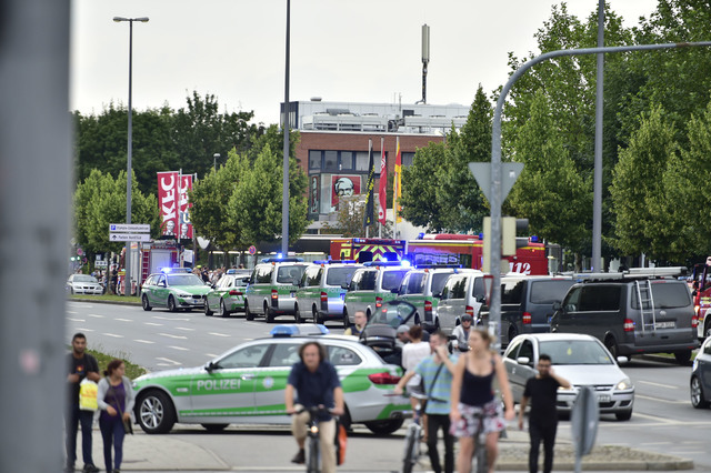 Police cars stand outside the Olympia shopping centre after a shooting was reported there in Munich, Friday, July 22, 2016. Several people have been reported to be killed. (Marc Kleine-Kleffmann/AP)