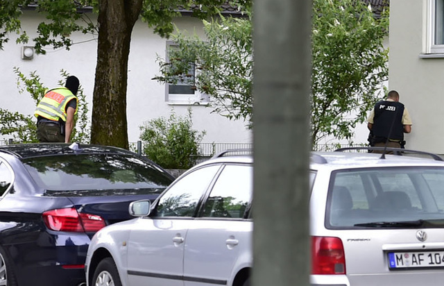 Police officer search a residential area near the Olympia shopping centre after a shooting was reported there in Munich, Friday, July 22, 2016. Several people have been reported to be killed. (Mar ...