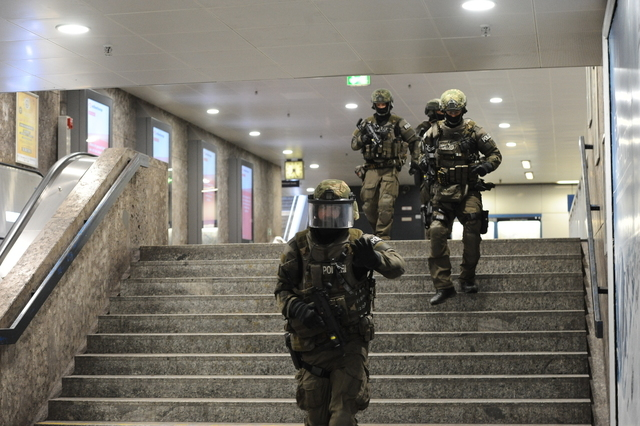 Heavily armed police forces walk through the underground station Karlsplatz (Stachus) after a shooting in the Olympia shopping centre was reported in Munich, Friday, July 22, 2016. (Andreas Gebert ...