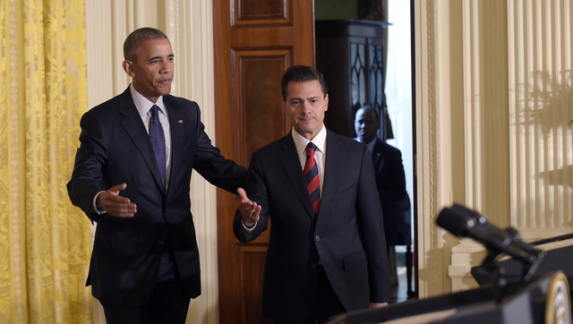 President Barack Obama, left, and Mexican President Enrique Pena Nieto, right, arrive for a news conference in the East Room of the White House in Washington, Friday, July 22, 2016.  (Susan Walsh/AP)