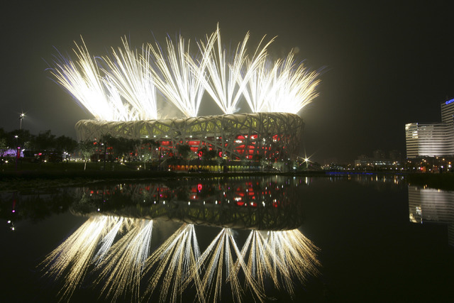 In this Aug. 8, 2008 file photo fireworks explode during the opening ceremony in the National Stadium at the Beijing 2008 Olympics in Beijing. The IOC said Friday July 22, 2016, that 45 more athle ...