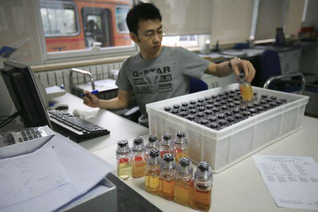 In this Monday, June 30, 2008 file photo, urine samples from Chinese athletes are recorded upon arriving at China Anti-Doping Agency in Beijing. The IOC said Friday July 22, 2016, that 45 more ath ...