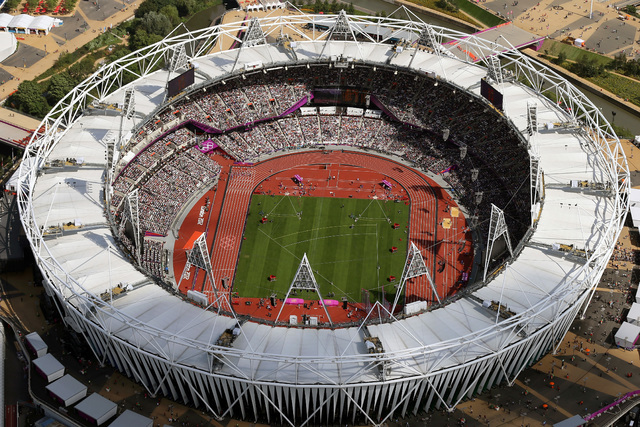 This is a Friday, Aug. 3, 2012 file photo of an aerial photo of the Olympic Stadium during the 2012 Summer Olympics at Olympic Park, in London. The IOC said Friday July 22, 2016, that 45 more athl ...