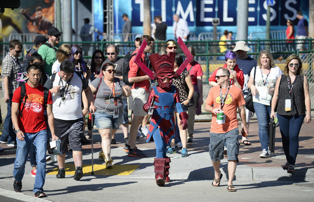 Bunny Knowble, dressed Galactus Eater of Worlds, crosses the street with the crowd on the way to Preview Night at Comic-Con International held at the San Diego Convention Center Wednesday July 20, ...