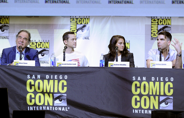 """Director/writer Oliver Stone, from left, Joseph Gordon-Levitt, Shailene Woodley and Zachary Quinto attend the """"Snowden"""" panel on day 1 of Comic-Con International on Thursday, July 21, 2016, in San ..."""