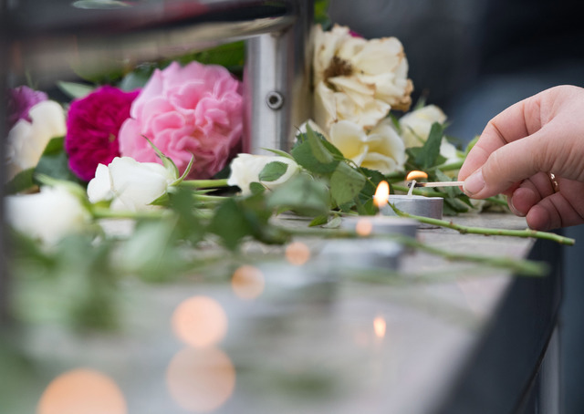 Candles are lit near a mall where a shooting took place leaving nine people dead the day before on Saturday, July 23, 2016 in Munich, Germany. (Sebastian Widmann/Associated Press)