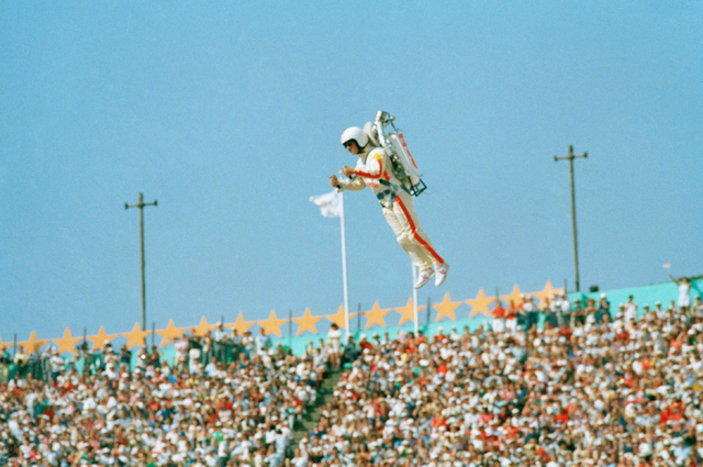 "FILE - In this July 28, 1984 file photo Bill Suiter ""Rocket Man"" soars with the help of a jet pack during the welcoming of nations at the Opening ceremonies of the 1984 Summer Olympics in the Los  ..."