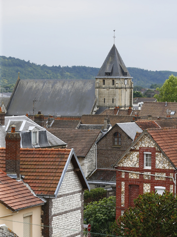 General view of the church where an 85-year-old priest was killed in an attack in Saint-Etienne-du-Rouvray, Normandy, France, Tuesday, July 26, 2016. (Francois Mori/AP)