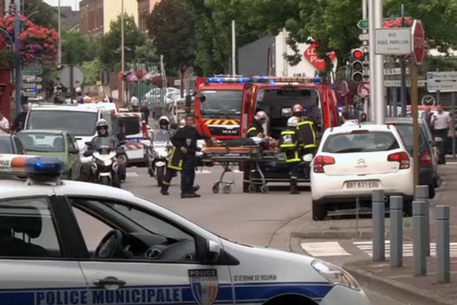 In this screen grab made from video, emergency services transport a person into a waiting ambulance in Normandy, France, Tuesday, July 26, 2016. Two attackers seized hostages in a church near the  ...