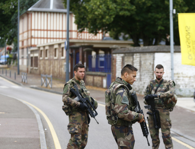 French soldiers stand guard as they prevent the access to the scene of an attack in Saint-Etienne-du-Rouvray, Normandy, France, Tuesday, July 26, 2016. (Francois Mori/AP)