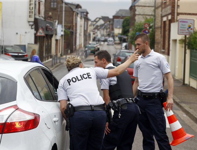 French police officers seal off one of the access to the scene of an attack in Saint-Etienne-du-Rouvray, Normandy, France, Tuesday, July 26, 2016. (Francois Mori/AP)