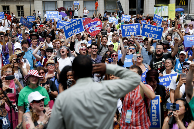 Supporters of Sen. Bernie Sanders, I-Vt., yell during a rally near City Hall in Philadelphia, Tuesday, July 26, 2016, during the second day of the Democratic National Convention. (AP Photo/John Mi ...