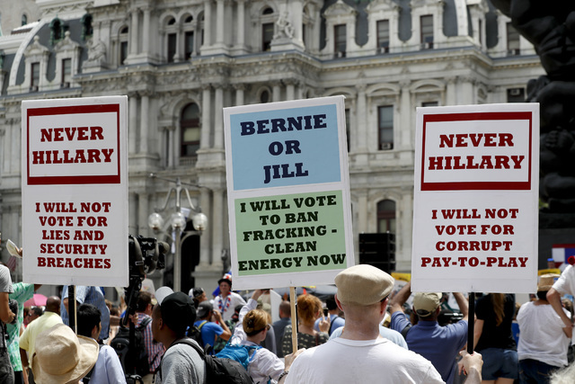 Supporters of Sen. Bernie Sanders, I-Vt., listen during a rally near City Hall in Philadelphia, Tuesday, July 26, 2016, during the second day of the Democratic National Convention. (AP Photo/Alex  ...