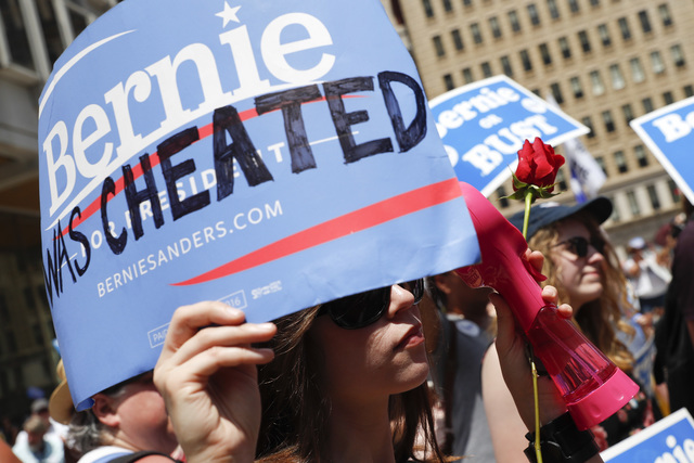 A supporter of Sen. Bernie Sanders, I-Vt., listens during a rally near City Hall in Philadelphia, Tuesday, July 26, 2016, during the second day of the Democratic National Convention. (AP Photo/Joh ...