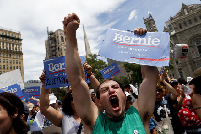 A supporter of Sen. Bernie Sanders, I-Vt., yells during a rally near City Hall in Philadelphia, Tuesday, July 26, 2016, during the second day of the Democratic National Convention. (AP Photo/John  ...
