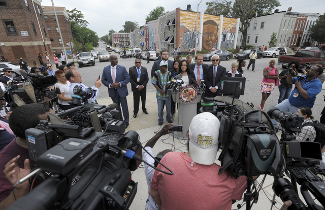 Baltimore State's Attorney Marilyn Mosby, right, holds a news conference near the site where Freddie Gray was arrested after her office dropped the remaining charges against three Baltimore police ...