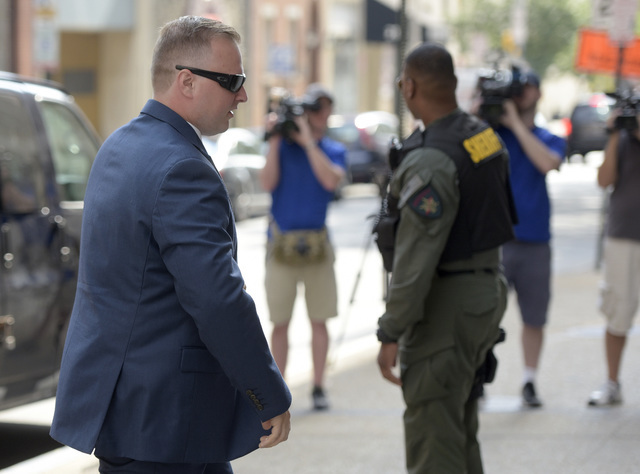 Officer Garrett Miller, one of the six members of the Baltimore Police Department charged in connection to the death of Freddie Gray, arrives at a courthouse for his pre-trial proceedings in Balti ...