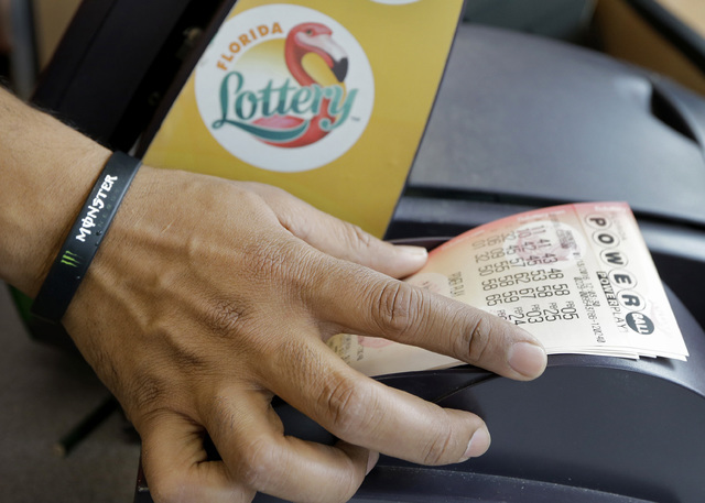 The Powerball jackpot for the Wednesday, July 27, 2016, drawing has soared to over $420 million, thanks to nearly three months without a winner of the big prize. (Chris O'Meara/AP)