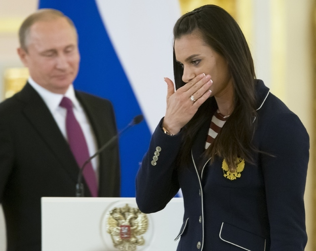 Russia's pole vaulter and Olympic champion Yelena Isinbayeva gestures after speaking at the Kremlin, in Moscow, Russia, Wednesday, July 27, 2016 during a reception for the Russia's Olympics team.  ...
