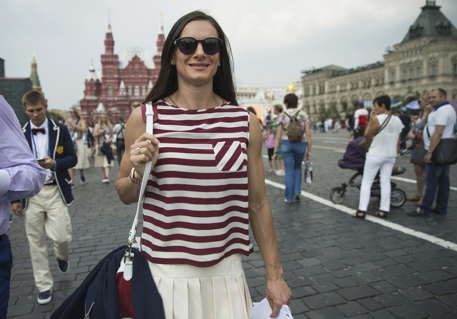 Russia's pole vaulter Yelena Isinbayeva with other Russia's National Olympic team members walk along the Red Square for a meeting with Russian President Vladimir Putin, in Moscow, Russia, Wednesda ...