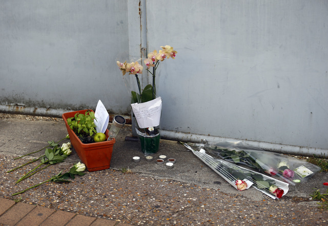 Flowers, candles and messages are placed at the home of the Rev. Jacques Hamel after he was killed during an attack in his church in Saint-Etienne-du-Rouvray, Normandy, France, Tuesday, July 26, 2 ...