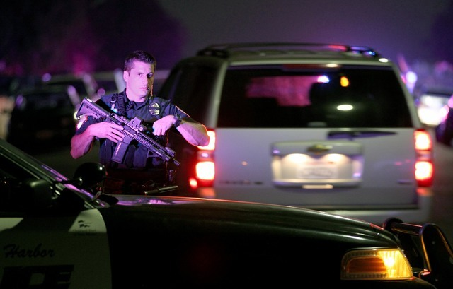 A San Diego Harbor Police officer helps to secure the scene in San Diego near where two San Diego police officers were shot Thursday night, July 28, 2016. (John Gastaldo/The San Diego Union-Tribun ...