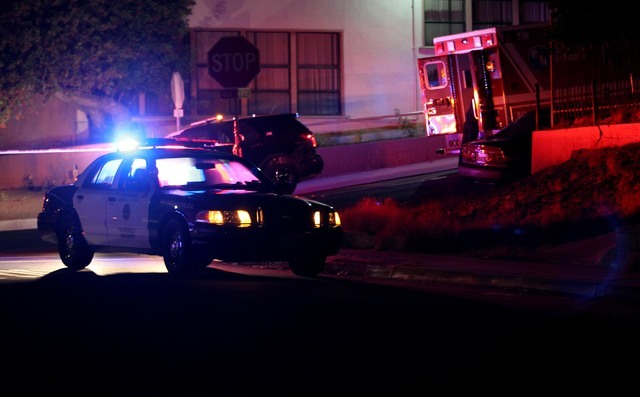 San Diego police and other law enforcement stage near the scene of a shooting of two San Diego police officers, Thursday night, July 28, 2016. (John Gastaldo/The San Diego Union-Tribune via AP)