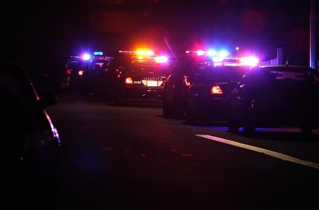 Police cars line the scene in San Diego near where two police officers were shot Thursday night, July 28, 2016. (John Gastaldo/The San Diego Union-Tribune via AP)