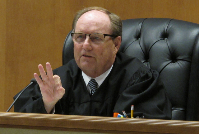 Shawnee County, Kan., District Judge Larry Hendricks makes a comment during a hearing on requiring the state to count potentially thousands of votes in state and local elections from people who've ...