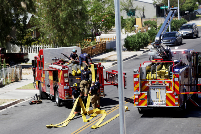 Firefighters clean up after responding to a house fire at 309 N. Eighth St. near Las Vegas Boulevard Saturday, July 16, 2016, in Las Vegas. Rachel Aston/Las Vegas Review-Journal Follow @rookie__rae