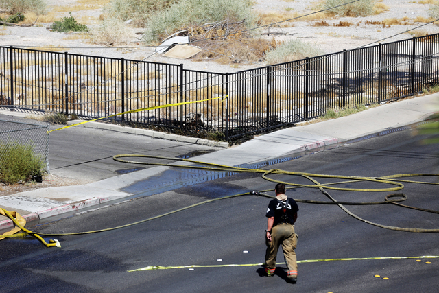 The corner of an empty lot on 8th Street still had small flames after a fire at 309 N. Eighth St. near Las Vegas Boulevard Saturday, July 16, 2016, in Las Vegas. Rachel Aston/Las Vegas Review-Jour ...