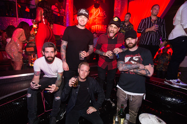 Members of A Day to Remember with Tal Cooperman, in red, at Drai's Nightclub on July 23, 2016, atop The Cromwell. (Jesse Sutherland/Tony Tran Photography)
