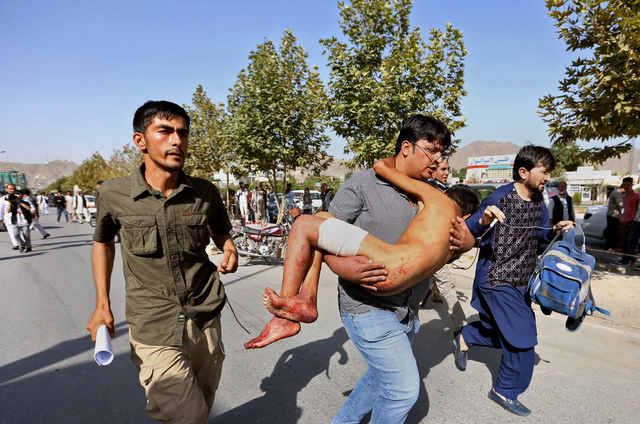 An injured boy is carried to a hospital after an explosion struck a protest in Kabul, Afghanistan, Saturday, July 23, 2016.  (Rahmat Gul/The Associated Press)