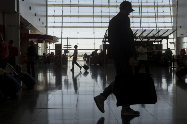 Travelers pass through McCarran International Airport in Las Vegas on June 7, 2016. (Bridget Bennett/Las Vegas Review-Journal) Follow @bridgetkbennett