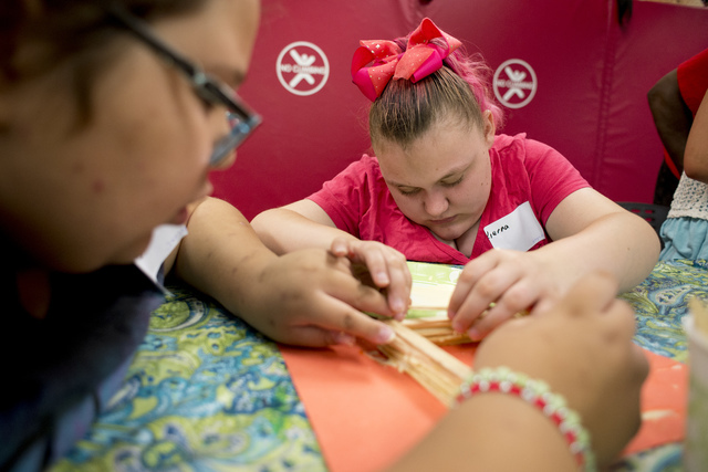 Hayley Jordan, 16, works on building a stick tower during arts and crafts time at Nevada Blind Children's Foundation Learning Center in Las Vegas June 16. Bridget Bennett/View