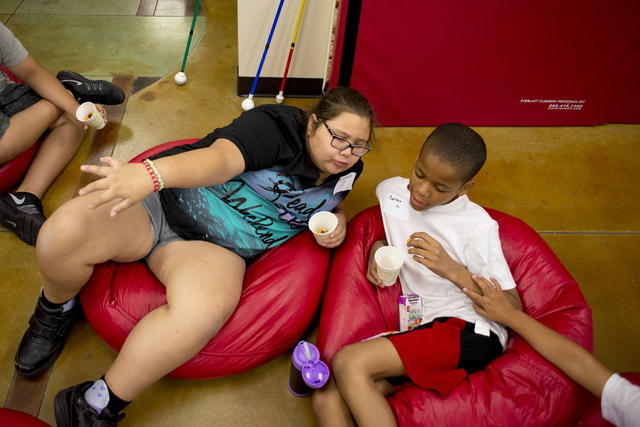 From left, Jensen Martin, 12, and Christian Lowe, 11, sing and make up songs during snack time at Nevada Blind Children's Foundation Learning Center in Las Vegas June 16. Bridget Bennett/View