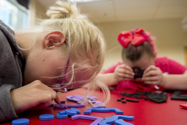 From left, Kristlynn Allison, 9, and Hayley Jordan, 16, build master bugs at Nevada Blind Children's Foundation Learning Center in Las Vegas June 16. Bridget Bennett/View Follow @bridgetkbennett o ...