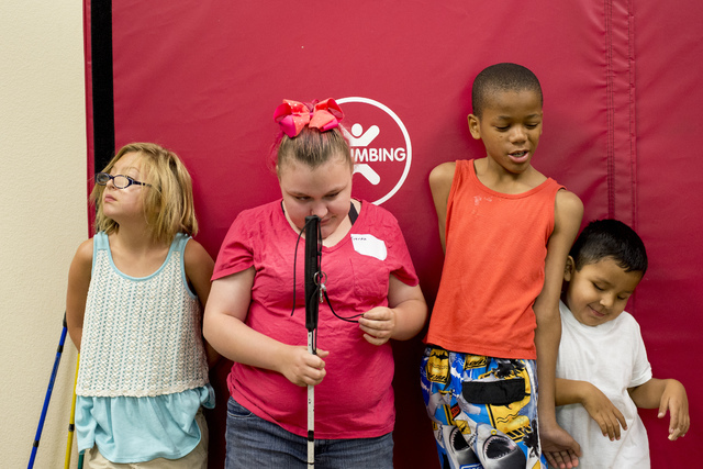From left, Ava Nalty, 9, Hayley Jordan, 16, Christian Lowe, 11, and Alexis Tolentino, 5, Nevada Blind Childrenճ Foundation Learning Center in Las Vegas June 16. Bridget Bennett/View