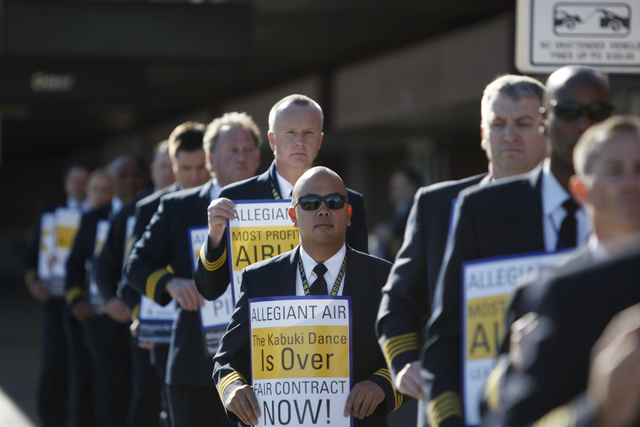 Allegiant air pilots participate in a picket line to call for a better contract at McCarran International Airport Terminal 1 Tuesday, Jan. 13, 2015. Allegiant pilots are represented by the Teamste ...