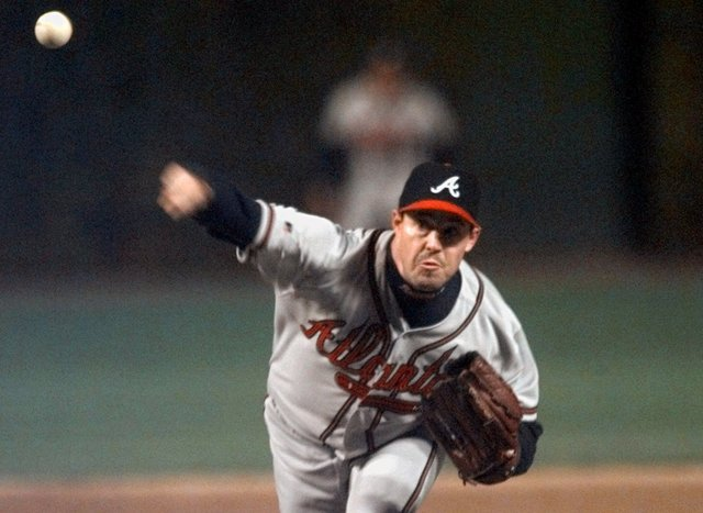 Atlanta Braves starting pitcher Greg Maddux throws in the first inning of game 3 of the National League Division Series against the Chicago Cubs in Chicago, Saturday, Oct. 3, 1998. (AP Photo/Morry ...