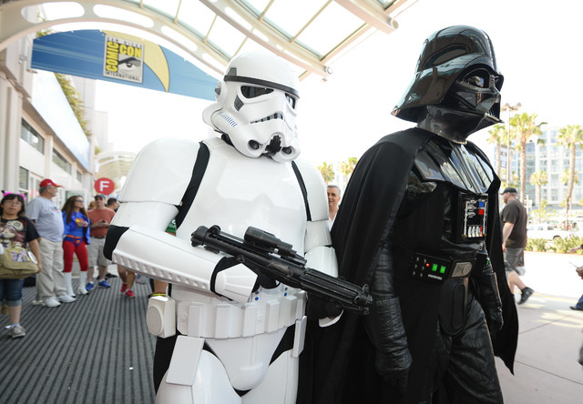Fans dressed as Star Wars characters walk in front of the convention center on day three of the Comic-Con International held at the San Diego Convention Center Saturday, July 23, 2016 in San Diego ...