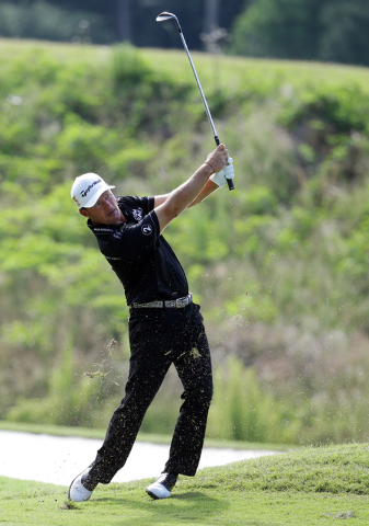 Alex Cejka, of Germany, hits from the sixth fairway during the second round of The Players Championship golf tournament Friday, May 13, 2016, in Ponte Vedra Beach, Fla. (Lynne Sladky/AP)