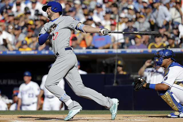National League's Kris Bryant, of the Chicago Cubs, follows through on a solo home run during the first inning of the MLB baseball All-Star Game against the American League, Tuesday, July 12, 2016 ...