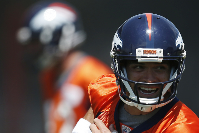 FILE - In this June 7, 2016, file photo, Denver Broncos quarterback Mark Sanchez runs during an NFL football practice at the team's headquarters in Englewood, Colo. One of the last things an NFL t ...