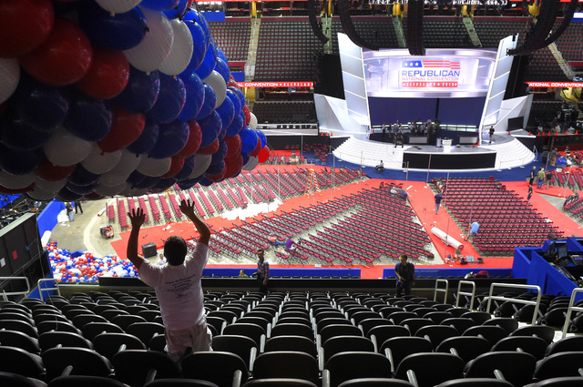 William Miranda positions balloons in preparation for the Republican National Convention at Quicken Loans Arena, Friday, July 15, 2016, in Cleveland, Ohio. (Mark J. Terrill/Associated Press)