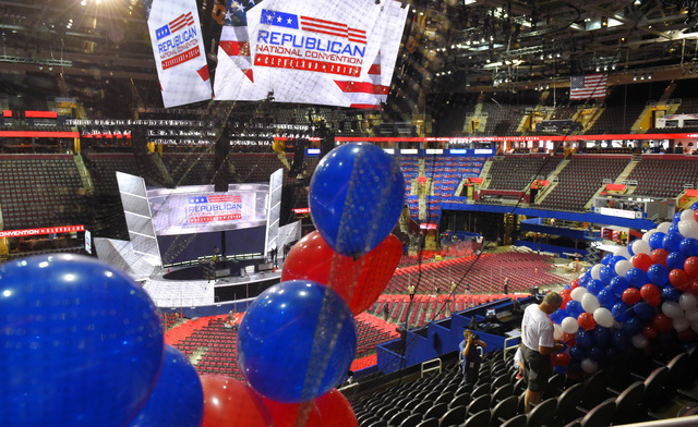 Workers install balloons in preparation for the Republican National Convention at Quicken Loans Arena, Friday, July 15, 2016, in Cleveland, Ohio. (Mark J. Terrill/Associated Press)