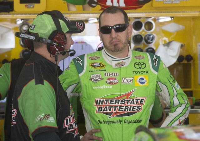 NASCAR driver Kyle Busch talks with his crew as he arrives for practice at New Hampshire Motor Speedway for Sunday's New Hampshire 301 auto race, Friday, July 15, 2016, in Loudon, N.H. (Jim Cole/T ...