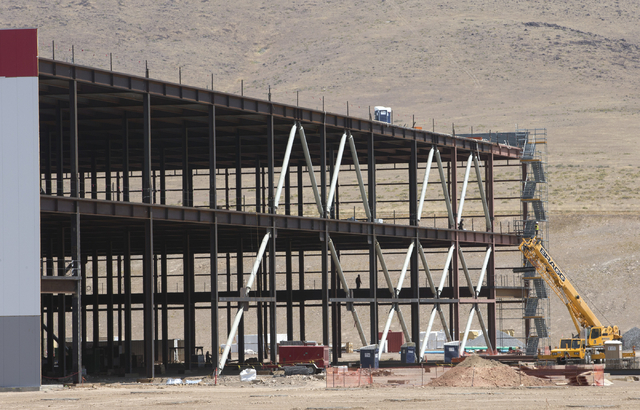 Construction continues on the new Tesla Gigafactory during a media tour Tuesday, July 26, 2016, in Sparks, Nev. Itճ Tesla Motorsՠbiggest bet yet: A massive, $5 billion factory in the N ...