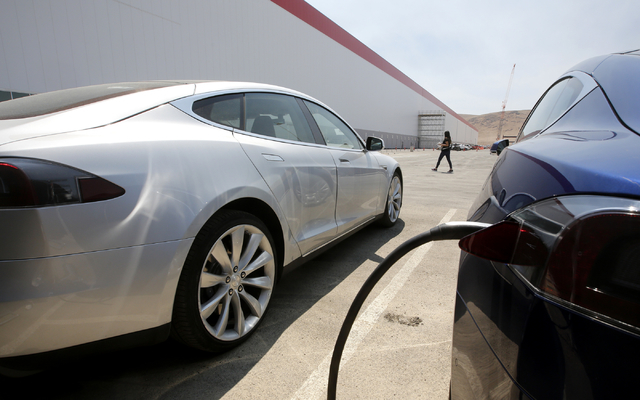 Tesla Motors model S cars are charged at the new Tesla Gigafactory, Tuesday, July 26, 2016, in Sparks, Nev. The Gigafactory is Tesla Motorsՠbiggest bet yet: A massive, $5 billion factory in  ...